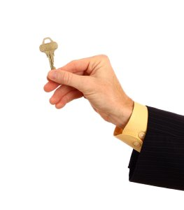 13274-a-hand-in-a-business-suit-holding-a-key-pv